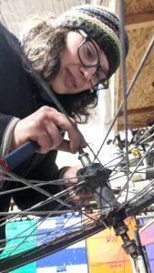 Women working on bike wheel